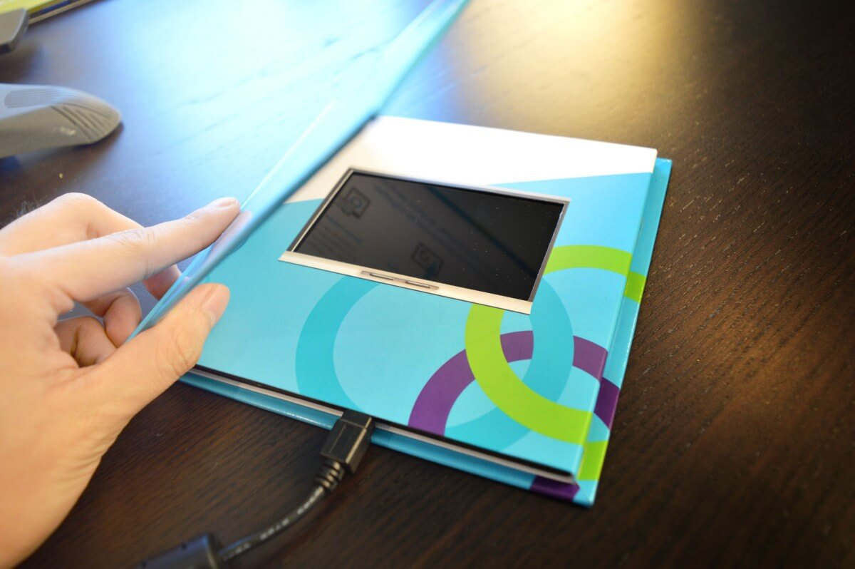 Smart custom video book with USB charger.