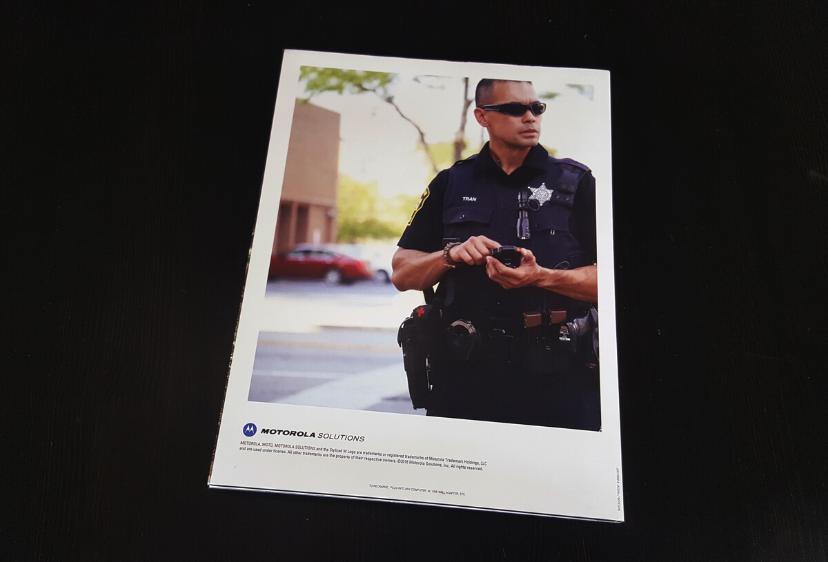 Motorola Solutions brochure with video screen.